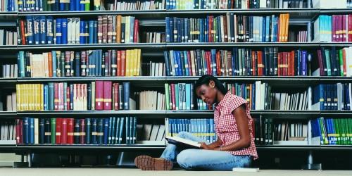 1007675851-o-AFRICAN-AMERICAN-WOMAN-READING-BOOK-facebook.jpg