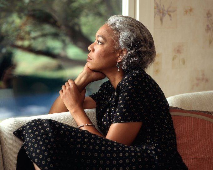 17075-an-african-american-woman-looking-out-a-window-pv.jpg