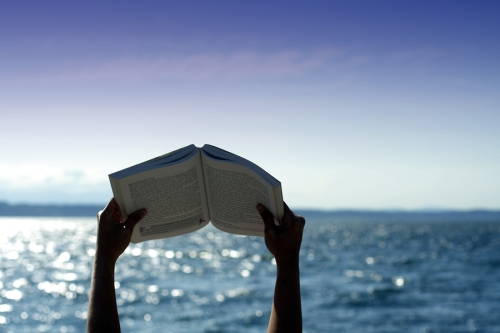 bigstock-Reading-On-The-Beach-589631.jpg